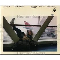 1996 Press Photo Passenger waiting for his flight at Portland International Airp