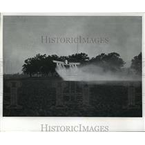 1977 Press Photo A pilot fought for height as his crop dusting plane in Delavan