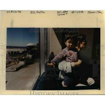 1998 Press Photo Father and son awaits at the Portland International Airport