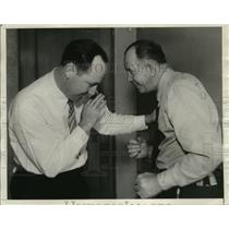 1934 Press Photo Jack Kearns boxer arrested on drunk charge, baliff Frank Keohan