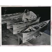 1951 Press Photo John Heuss assembles fighter jet pylons for Westinghouse