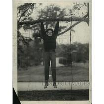 1923 Press Photo Boxer Johnny Kilbane Hanging From a Tree Limb - cvb74963