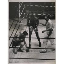 1936 Press Photo Boxer Al Wardlaw stands over Robert Burke during Golden Gloves