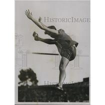 1928 Press Photo Miss M Clark wins high jump at British Empire games - net12249