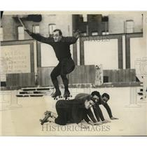 1928 Press Photo Rollerskater J Dalton jumps over J Dalton, J Landoff,N De Polo