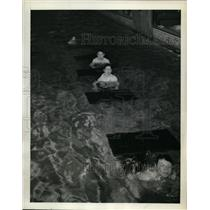 1943 Press Photo Boys Club swimmers in a pool with obstacles to swim under