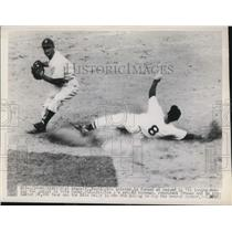 1949 Press Photo Al Evans of Nationals vs A's Pete Suder in DC game - net15291