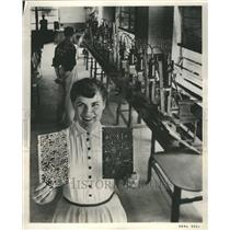 Press Photo Lady worker holding 30 foot long battery