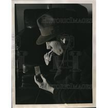 1939 Press Photo Intelligence Agent Reading information from Matchbook