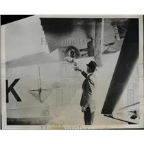 1935 Press Photo M.Cognot, Pilot shaking hands with well wisher before flight