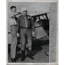 1951 Press Photo Bernarr McFadden Adjusts Life Preserver Before Parachute Jump