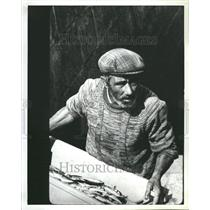 1987 Press Photo Portugal resident with fish bucket.