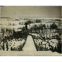 1927 Press Photo Ski jumper in action on slopes at a meet - net20220