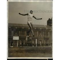 1927 Press Photo Allen Logan of Emery University in broad jump at U of PA