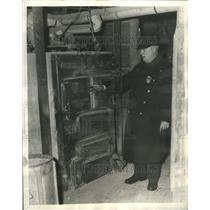 1934 Press Photo Dennis J. Hullisey Inspecting Boiler - RRR57181