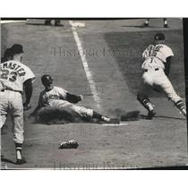 1964 Press Photo Del Crandell slides into home as Joe Torre lunges for throw.