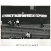 1965 Press Photo Sign in back of bleachers showed some fans still hoped.