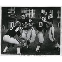 1956 Press Photo Harry Kaminsky (44) shows form for University of Wisconsin.