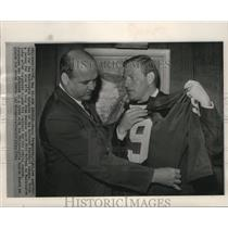 1964 Press Photo Sonny Jurgensen poses with new jersey after signing contract.