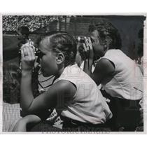 1954 Press Photo Sandra Lackas and Sandra Dais watch Braves game from stands.