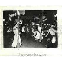 1975 Press Photo Group Carnival Maskers Carrying Fire Torches in New Orleans