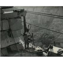 1949 Press Photo Man operating a drill on ledge of Barre Vermont quarry