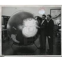 1956 Press Photo Doctor Grayson Kirk showing south pole region at Columbia U