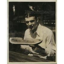 1931 Press Photo Boxer Young Stribling eating watermelon at training camp