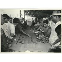 1959 Press Photo Laos-Customs, Recreation & Sports, Gambling is a Popular Sport.