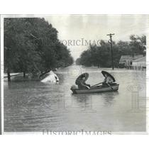 1954 Press Photo 117th & Crawford_Rowing Home in Flood