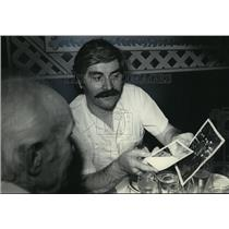 1985 Press Photo George Myers, Pierre Briere Discuss World War II Photograph