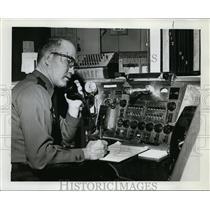 1961 Press Photo Patrolman Carl Dunafon receives report at Portland Police Radio