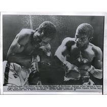 1956 Press Photo Hurrican Jackson takes a hard hit from Floyd Patterson in 11th