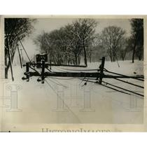 1929 Press Photo One of the Telegraph and Power Poles Which Fell Across Tracks