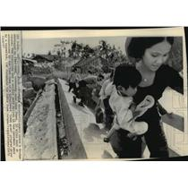 1973 Press Photo Long Thanh, Vietnam Villagers Crossing Destroyed Bridge