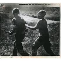 1969 Press Photo Wounded US Infantryman Led in South Vietnam Rice Paddy