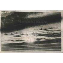 1939 Press Photo Squadron Of British Planes Fly Into The Rising Sun - nef63647