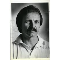1979 Press Photo Bill Rozich, wearing an open- neck white golf shirt - ora75288