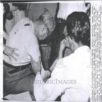 1960Press Photo Knifed Socialist Leader Given First Aid
