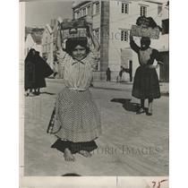 1954 Press Photo Portuguese Girl Bundle Balancing - RRY39181