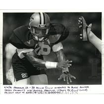 1986 Press Photo New Orleans Saints - Willie Tullis attempts block at practice.