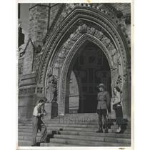 1958 Press Photo Royal Canadian Mounty Takes Picture w/ Girl Parliament Building