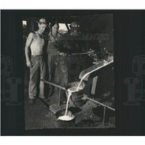 Press Photo Black Molten Iron Casting Work