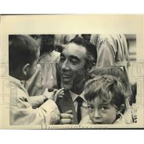 1964 Press Photo Young Children Surround Anthony Quinn Joins CARE Staff