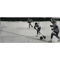 1965 Press Photo People playing roomball on the ice with referee in background