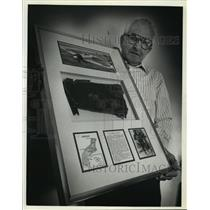 1992 Press Photo Frank Buchholz holds the wall plaque about Pearl Harbor
