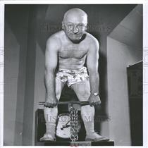 1956 Press Photo Merrill Pierson uses dynamiter