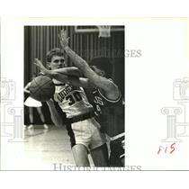 1989 Press Photo Lutheran's Joey Althage is fouled by Ganus' Chris Maples.