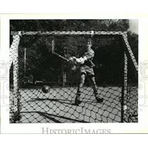 1991 Press Photo John Almy plays hockey in Audubon Park near Magazine St.