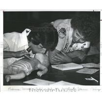 1983 Press Photo Red Cross CPR Class Woman Testing
